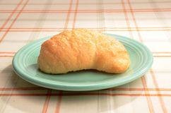 Crossiant on a saucer Royalty Free Stock Images