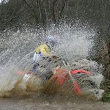 Crossing. Motorcycle race on a cross-country terrain Royalty Free Stock Photos