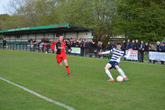 Crossing the Ball. AFC Haywards Vs Cuckfield cup final football match, `Tester Challenge Cup` at Burgess Hill Stadium, UK, 28th April 2015 Stock Image