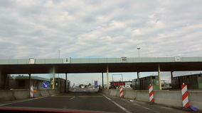 Crossing the border between Hungary and Austria. HUNGARY - CIRCA 2016: Crossing the border between the Hungary and Austria with police officers surveilling the stock video footage