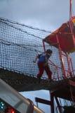Crossing the Bridge (2). A boy crossing a bridge at an amusement park stock photo