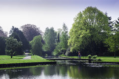 Crossing The Bridge. A beautiful park at the cozy little town of Bussum, Netherlands stock images