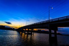 Crossing the bridge. Tha Chin River Bridge in the evening in Thailand royalty free stock photos
