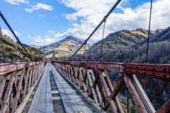 Crossing the bridge to the mountains Royalty Free Stock Image