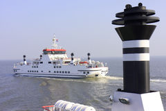 Crossing a Cargo Boat and way back to Ameland stock images