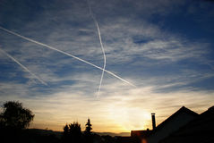 Crossing condensation trails. The image shows two crossing condensation trails on the sky. The lines of the vapor are forming an 'x'. The picture was taken stock image