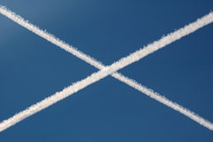 Crossing contrails. In a clear summer sky stock photography