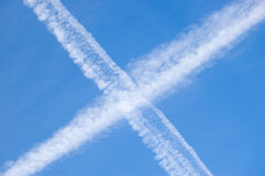 Crossing contrails. In the sky Stock Image