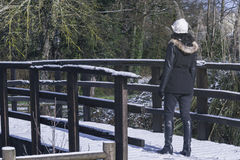 Crossing a covered with snow bridge Stock Photos