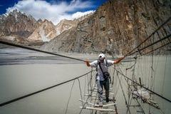 Crossing dangerous bridge Stock Photography