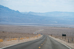 Crossing Death Valley. A typical USA desert road. Death Valley Raw Landscape stock photo