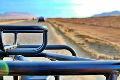 Crossing the desert in a buggy stock image