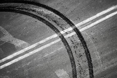 Crossing of double dividing lines road marking and tires track Royalty Free Stock Photography