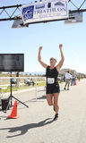 Crossing the finish line. Royalty Free Stock Image