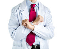 Crossing fists gesture by doctor in white coat Stock Photo