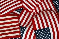 Crossing flags. Several American flags overlapping over each other Royalty Free Stock Image