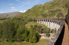Crossing the Glenfinnan Viaduct on the Jacobite. Crossing the Glenfinnan Viaduct on board the Jacobite Steam train running from Fort William to Mallaig in the Royalty Free Stock Images