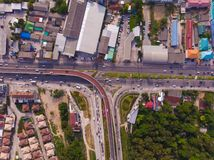 Crossing highway in rural area from a green plantation from a bird`s eye view in Thailand, top view royalty free stock photography