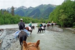 Crossing on the horseback over the river, Caucasus Royalty Free Stock Images