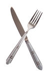 Crossing knife and fork isolated Royalty Free Stock Photo