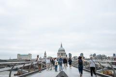 Crossing the Millennium Bridge, London. Stock Photo