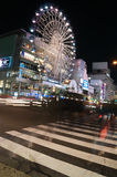 Crossing at night in front of the Sunshine Sakae building Nagoya, Japan Stock Photo