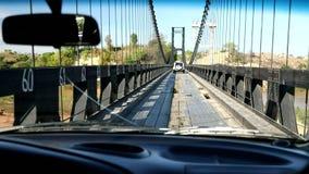 Crossing old famous eiffel bridge over madagascar river