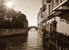 Crossing over the channel. Sepia image of Venice. Stock Image