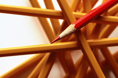 Crossing pencil. A red isolated pencil, the best of the best Royalty Free Stock Photography