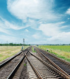 Crossing of railroad under cloudy sky Royalty Free Stock Photos
