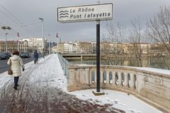 Crossing the Rhone river on Lafayette Bridge. LYON, FRANCE, March 1, 2018 : Trafic on a bridge over Rhone River, as a cold spell rages in all Europe and the Royalty Free Stock Photography