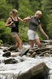 Crossing through river Stock Image