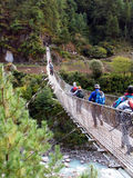 Crossing the river. Bridge over a river in Nepal, on the way to Kumbhu valley and Everest Royalty Free Stock Photography