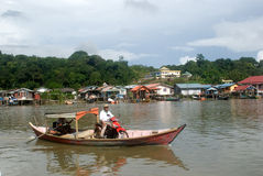 Crossing the river, Kampung Bako, Borneo, Malaysia Royalty Free Stock Photo