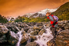 Crossing the river on trek Stock Photos