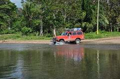 Crossing rivers in the Osa Peninsula, Costa Rica.  Royalty Free Stock Images