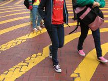 Crossing the road. In yellow pattern Stock Photography