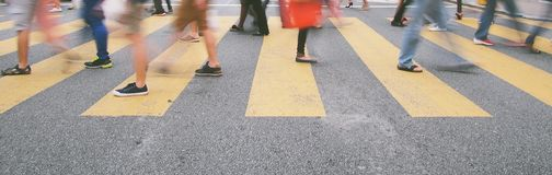 Crossing the road on zebra line. Crossing the road and the blurred part is to show motions Stock Photo