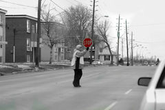 Crossing safely. Crossing guard stopping traffic so children can cross street Royalty Free Stock Photo