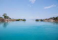Crossing with a sail boat or yacht trough the Channel of Corinth Stock Image
