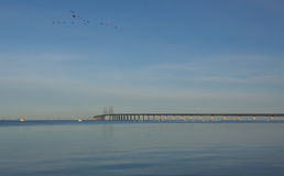 Crossing the sea. View of the bridge between Denmark an Sweden in early morning in October Royalty Free Stock Photos