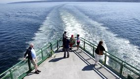 Crossing sea ferry. Passengers were riding a ferry from Edmonds to Kingston to travel to the Olympic National Park, near Seattle stock footage