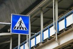 Crossing sign. Blue pedestrian crossing street sign in Bangkok Thailand royalty free stock photos