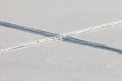 Crossing snowmobil tracks in powder surface Royalty Free Stock Photo