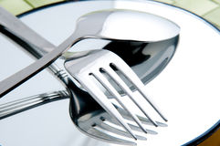 Crossing Spoon and Fork. On the cycle mirror Stock Photo