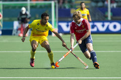 Crossing sticks. THE HAGUE, NETHERLANDS - JUNE 2: English field hockey player Ashley Jackson crosses sticks with an unidentified Indian player at the Rabobank Royalty Free Stock Photos