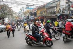Crossing the streets of Hanoi Stock Photos