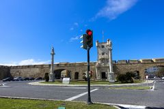 Crossing streets with traffic light at fortress in Cadiz, Andalusia stock photography