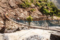 Crossing the suspension bridge Royalty Free Stock Images
