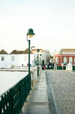Crossing Tavira Bridge. Bridge walk path with a vintage lamp pole Royalty Free Stock Images